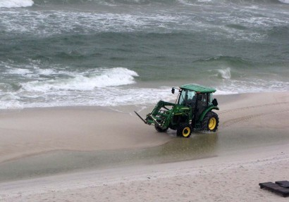 John Deere Tractor on beach at Panama City Beach in Florida.