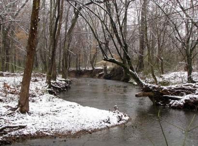 Snow on banks along creek.