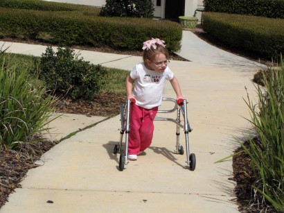 picture of little girl using walker