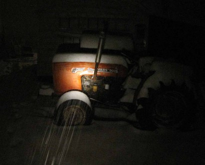 picture of tractor in snow at night
