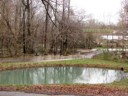 picture of pond and flooded rural road